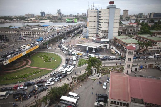 """12 May 2011, Lagos, Nigeria --- Lagos, Nigeria- A """"go slow"""" builds in Lagos, Nigeria on Thursday, May 12, 2011. Lagos is home to 10-18 million people making traffic a major problem but due to improvements made by Lagos State Governor, Babatunde Raji Fashola, """"go slows"""" have improved significantly. (Jane Hahn) --- Image by © Jane Hahn/Corbis"""
